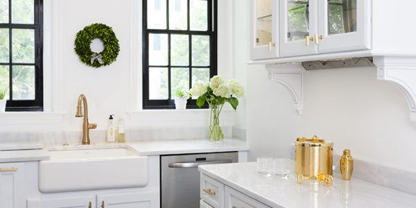 Kitchen remodeling in Northern VA, DC, MD, white cabinets, quartzite counters, stainless steel appliances, brass fixtures, subway tile
