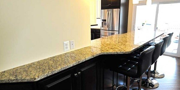 Kitchen remodeling in Northern Virginia, Maryland, & Washington, DC; eat-in kitchen; white and black cabinets; stainless steel appliances; granite countertops
